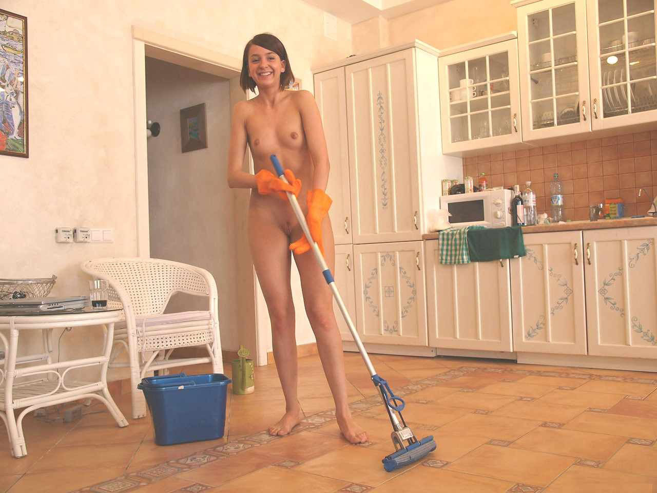 Nude woman doing house work, shannon doherty playboy pictures